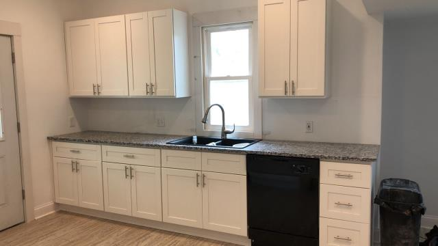Olathe, KS - Kitchen remodel & installation of newer, modern cabinets to make kitchen look more up-to-date.