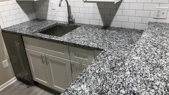 Kansas City, MO - Counter top replacement during kitchen remodel.  New, attractive counters make kitchen look much more modern and inviting.
