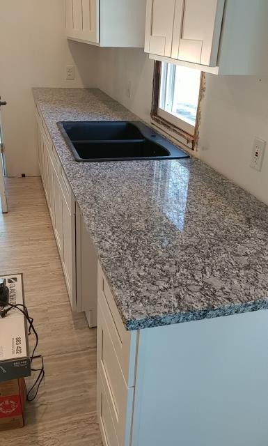Olathe, KS - New granite countertop install, ready for a Glacier Bay faucet!
