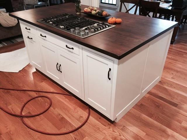 Raytown, MO - New kitchen island with custom wood counter and stainless steel cooktop