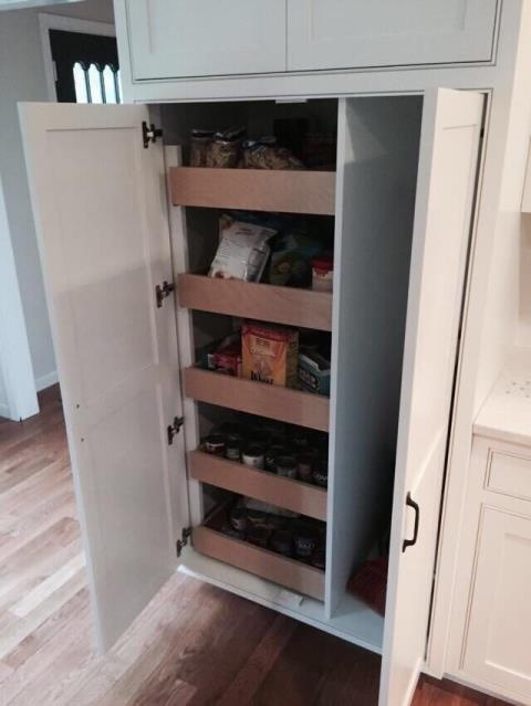Raytown, MO - Create a dream pantry to suit all of your needs- slide out drawers for all the canned and dried goods, plus, extra room for cleaning supplies and more.