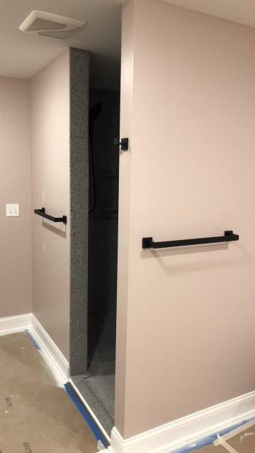Raymore, MO - Master bath remodel:  Dark bronze towel bars and shower hooks outside custom shower build.