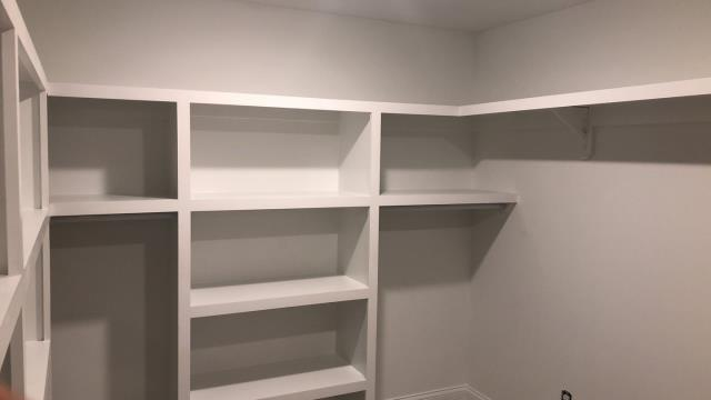 Raymore, MO - Custom built Master Bedroom Closet- a place for everything!