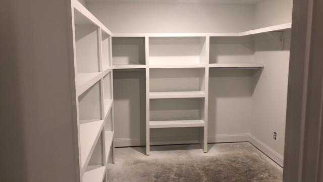 Raymore, MO - Master Bedroom Closet build - tons of storage for anything and everything