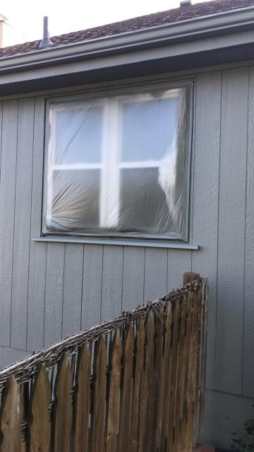 Raymore, MO - Exterior Paint- Be sure to properly cover all windows when spraying or painting your house. This helps to avoid unnecessary scraping and cleaning later.