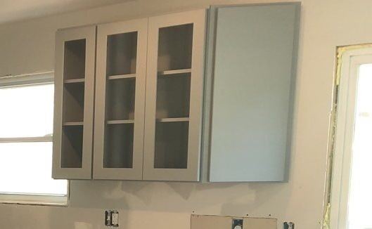 Kansas City, MO - Kitchen cabinetry with glass inserts- lightens up the space while still allowing for plenty of storage.