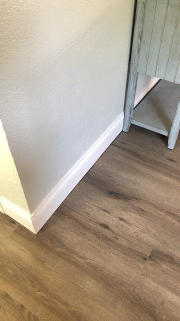Kansas City, MO - Crisp white baseboard completes a look in any room after new flooring is installed.