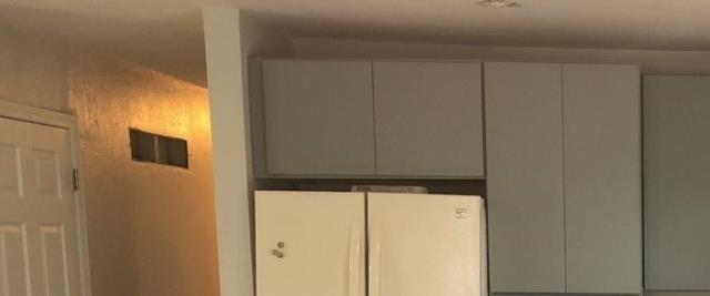 Kansas City, MO - Be sure to use the square footage above the fridge for extra storage.  A cupboard above it can provide plenty of extra space for your kitchen items.