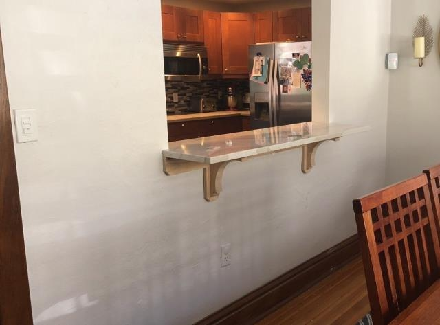 Kansas City, MO - For easy entertaining, add a small serving counter between your kitchen and dining room. It opens the space and is highly functional as well.