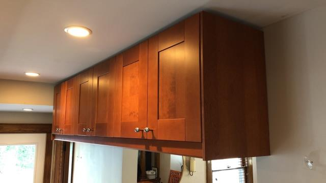 Kansas City, MO - Use all your kitchen square footage by mounting high upper cabinets in the extra space. This gives more storage for the items you need but don't use as often.