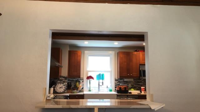 Kansas City, MO - A vinyl window installed near the sink gives great light and breaks up the space between the cabinets.  Plus, you may have a nice view while washing dishes!