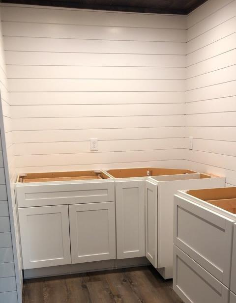 Lee's Summit, MO - Shiplap is a popular option today in many rooms.  Here it is used in a pantry/laundry room, but would look great in a kitchen or bath as well on an accent wall, or all around.