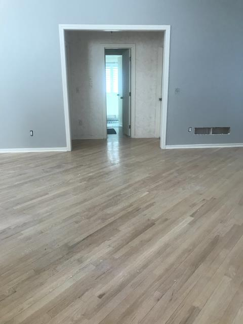 Lee's Summit, MO - Sanding and re-staining your wood floors is a great way to update an old look to new.
