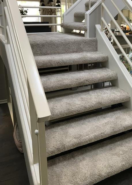 Lee's Summit, MO - Floating stairs are an eye popping accent and open up the space in your home.  Carpet, wood, or  laminate is a good choice to complete the look.