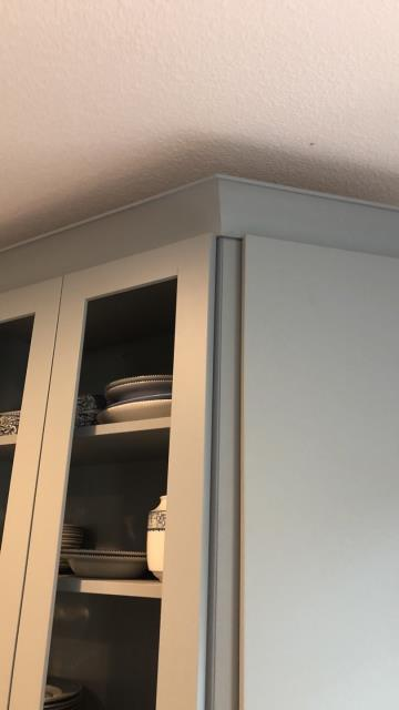 Kansas City, MO - Finish upper cabinets with crown molding.  There are many options- you can do a simple addition to the top as an accent, or bring it all the way to the ceiling to close off the space.