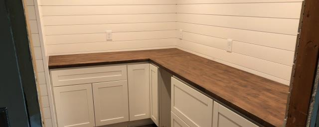 Lee's Summit, MO - A wood countertop is a great alternative to the usual granite or laminate choices.  Not only is it visually appealing, but it can be repaired if damaged simply by refinishing it.
