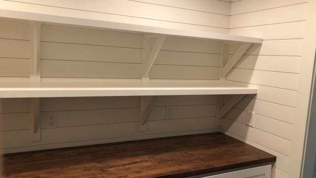Lee's Summit, MO - Custom made shelves are a great solution for any area where you need extra storage.  Here, they service a pantry/laundry room.