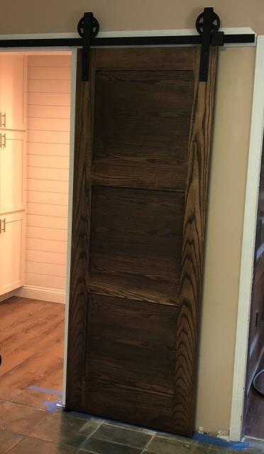 Lee's Summit, MO - Don't have room for a regular door? Or, want to try something different?  Install a barn door for a new look that takes up minimal space and looks beautiful as well.