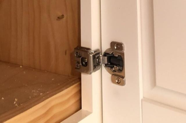 Lee's Summit, MO - European, or concealed hinges are a great choice if you want a clean, uncluttered look to your kitchen.  They install on the inside of the door, making it invisible to the outside of the cabinet.