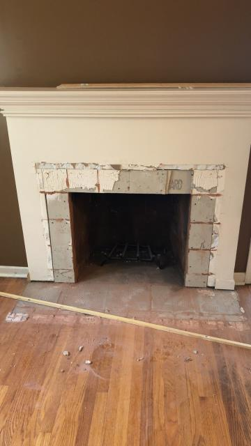 Need a fireplace update? There are many options today for materials: stone, brick, or several different kinds of wood.  Reclaimed wood is an economical choice and can be used many different ways.