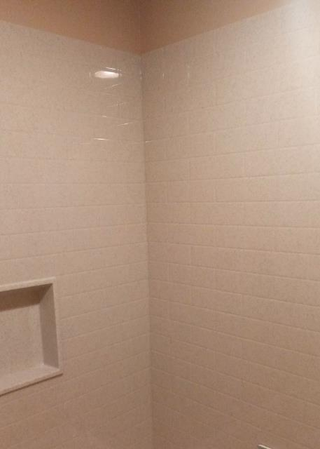 Onyx Collection provides many options for shower wall panels.  They are seamless so no grout is needed.