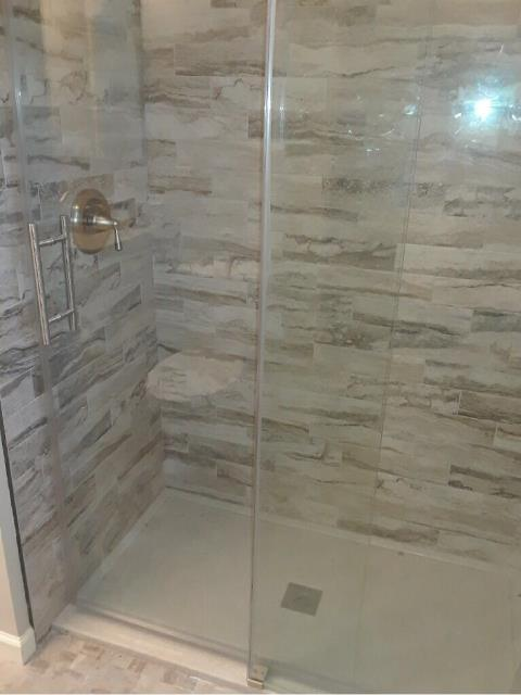 Glass shower doors are a beautiful way to showcase your newly tiled space.