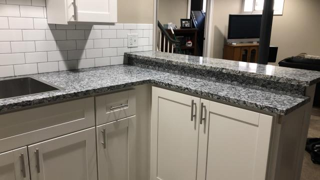 A simple design can still make a huge impact.  Subway tile backsplash and granite counter tops make a great pair.