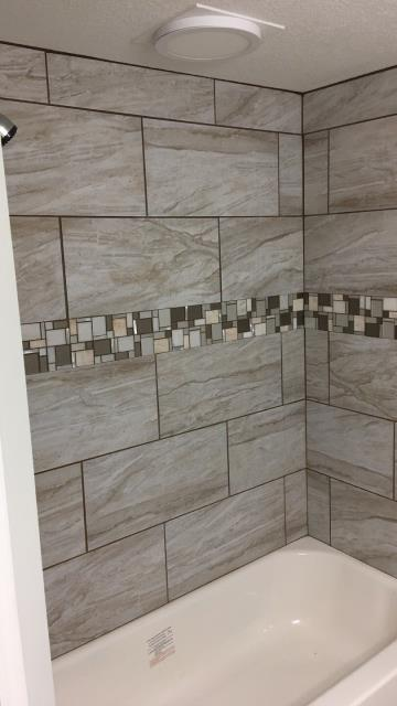 Adding an inlay can spice up the look and feel of your shower.