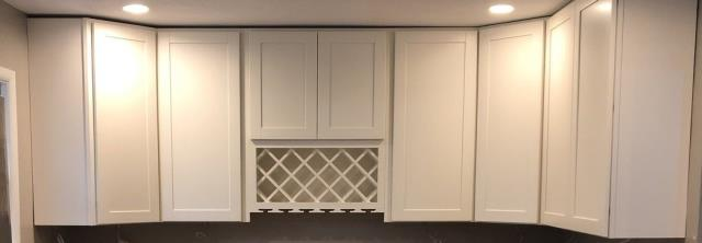Adding a built in wine rack is a creative way to add storage and a little personality to your kitchen space.