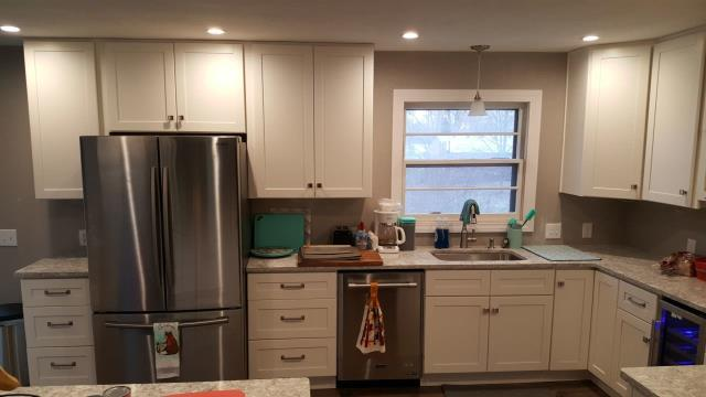 The cabinet pulls compliment the stainless steel appliances in this kitchen remodel.