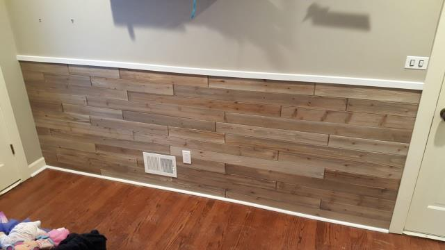 Using reclaimed wood creates a nice accent on the wall.