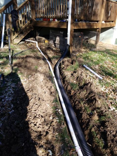 Installing a french drain from your down spouts will help move water away from your foundation.
