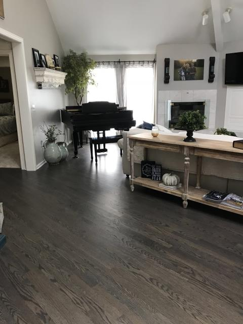 Refinishing existing hardwood floors can be more cost effective and still give a fresh look to your living area.