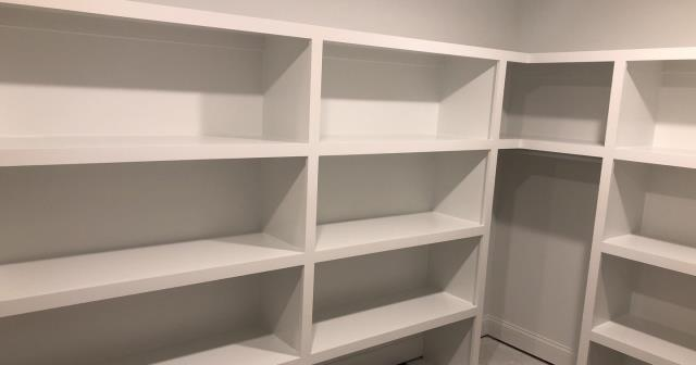 Adding custom shelving in your closet can increase your storage space.