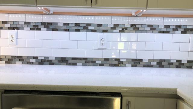 Liberty, MO - The under cabinet lighting reflects off the backsplash in this kitchen.