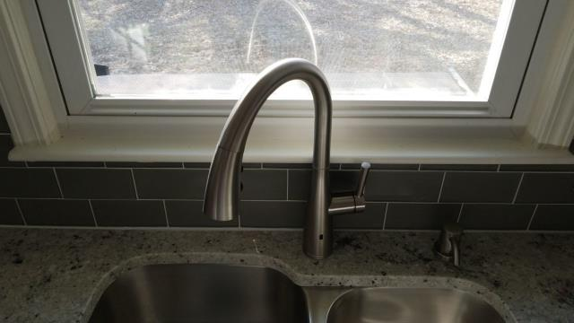This is an Essa Single-Handle Pull-Down Sprayer Kitchen Faucet with MagnaTite Docking.