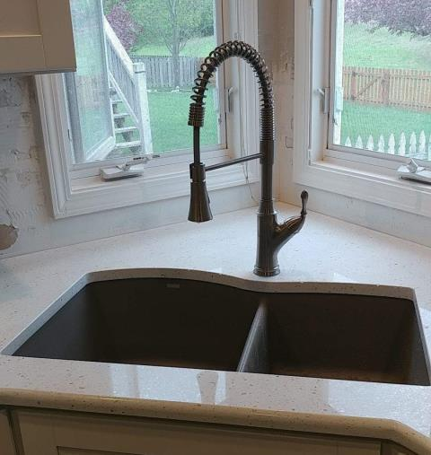 This kitchen features a VCCUCINE pull down faucet and undermount kitchen sink.