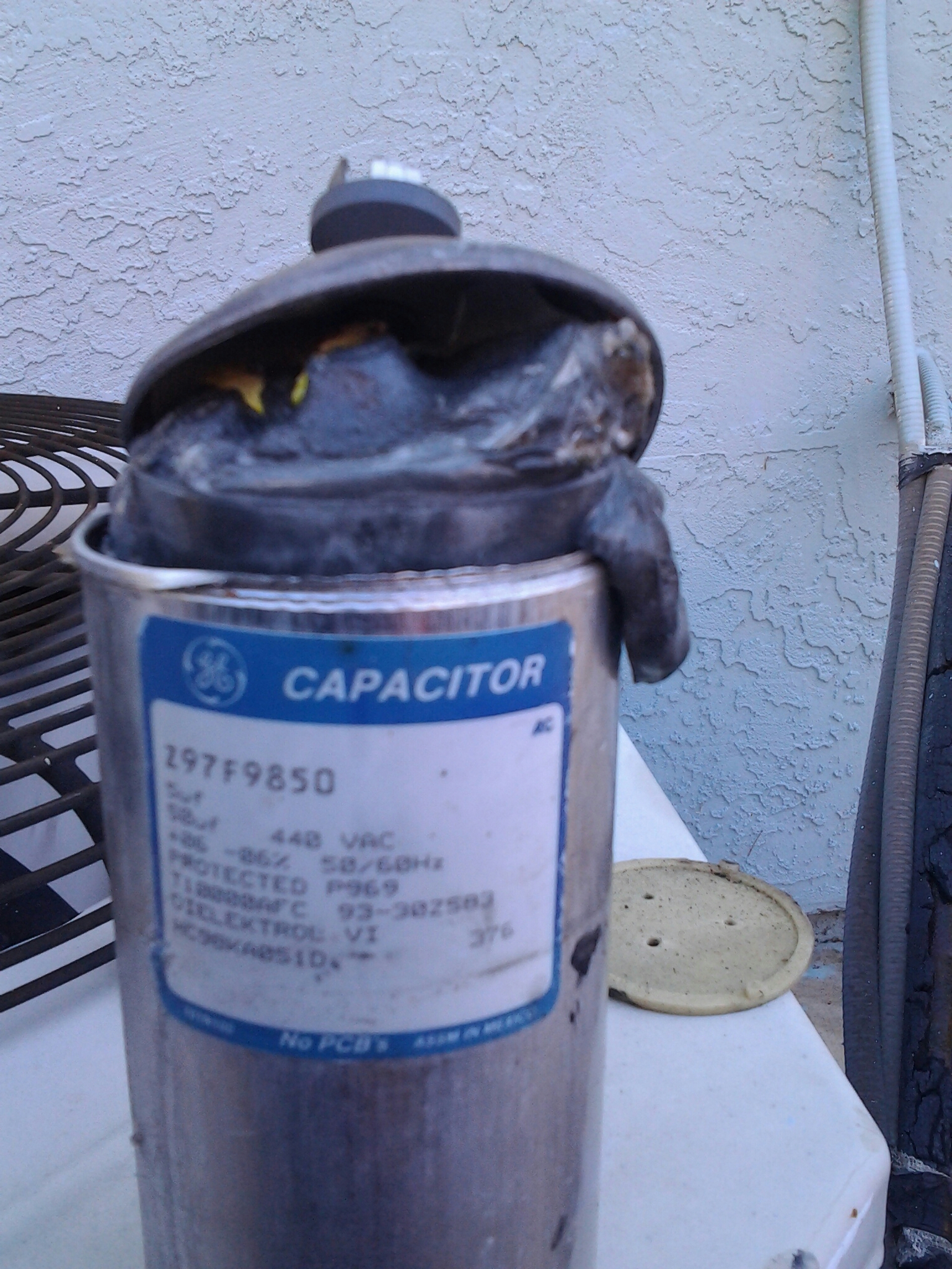 Oakley, CA - Working on a day and night air conditioner that was not running found the made in Mexico dual capacitor is blown up replaced with a new American made the bastard started and tested