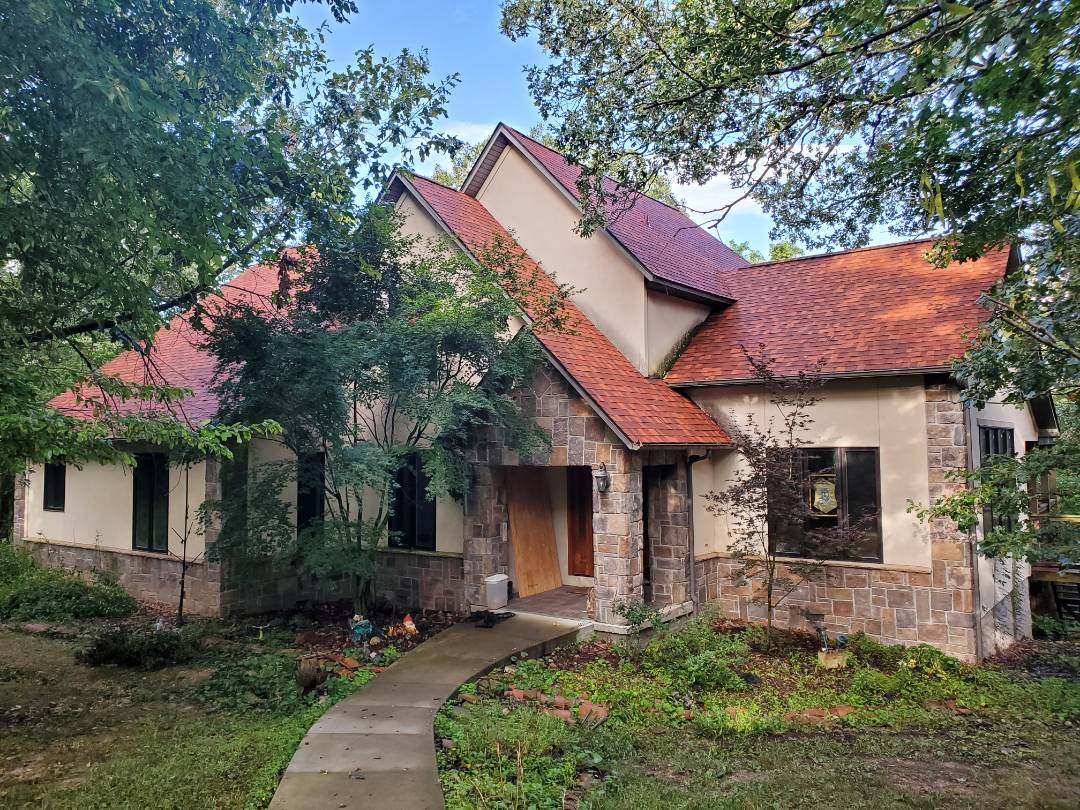 Eureka Springs, AR - Full roof replacement complete in Eureka Springs. This is an Owens Corning TruDefinition Duration shingle (Terra Cotta). Call Quality Assurance Roofing today.