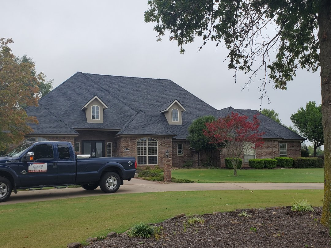 Bentonville, AR - Full roof replacement complete in Bentonville. This is a Malarkey Vista Class 3 Impact Resistant shingle (Midnight Black). Quality Assurance Roofing was able to get the entire roof paid for by the homeowners insurance company due to hail damage. Call Quality Assurance Roofing today for your free inspection.