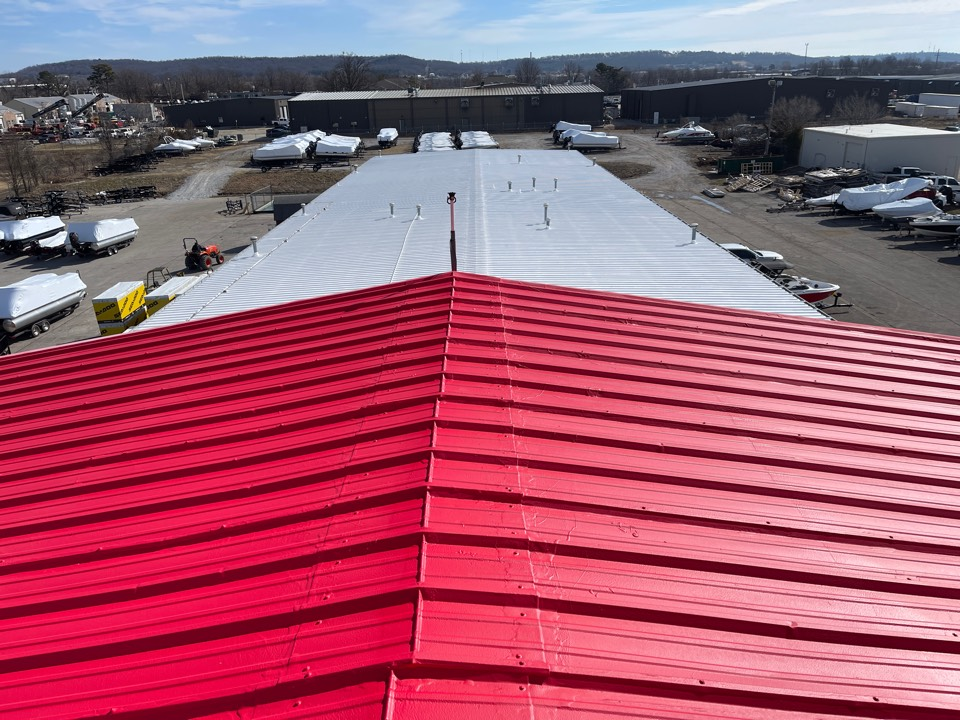 Springdale, AR - Quality Assurance Roofing just completed this Roof at Bradford Marine in Springdale Ar. We used a safety red acrylic red from Polyglass and   A white silicone fluid application on the building and it turned out beautiful. They now have an energy star rated roof and a 20 NDL warranty.
