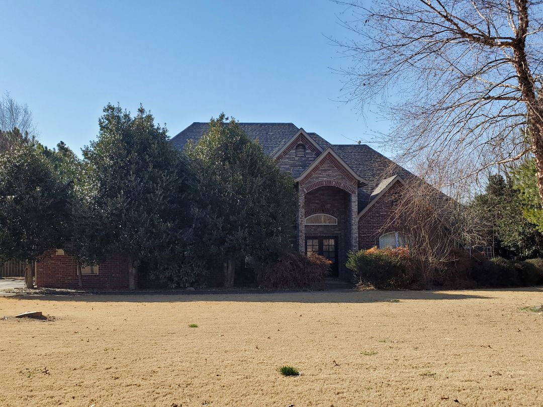 Springdale, AR - Full roof replacement complete in Springdale. This is a CertainTeed Landmark shingle (Weathered Wood). Quality Assurance Roofing was able to get the entire roof paid for by the homeowners insurance company due to storm damage. Call Quality Assurance Roofing today for your free inspection.
