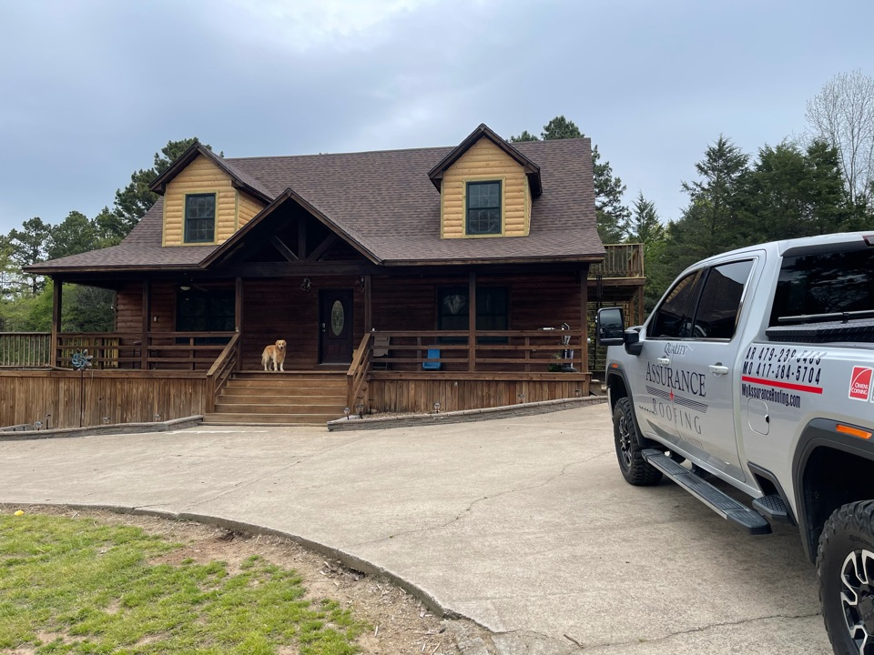 Dover, AR - The new roof on this beautiful log cabin in Russellville Ar is a Landmark Burnt Sienna Shingle, and the customer couldn't be happier.
