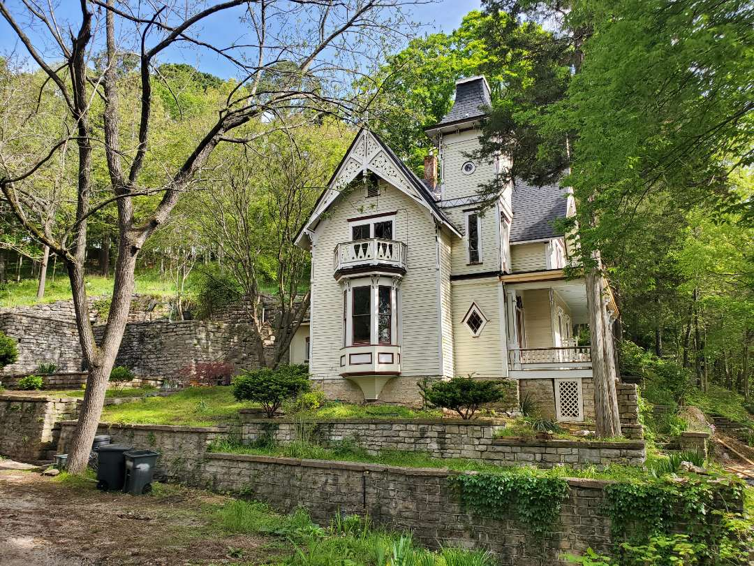 Eureka Springs, AR - Full roof replacement complete on this beautiful historic home in Eureka Springs. This is a CertainTeed Landmark shingle (Moire Black). Call Quality Assurance Roofing today.