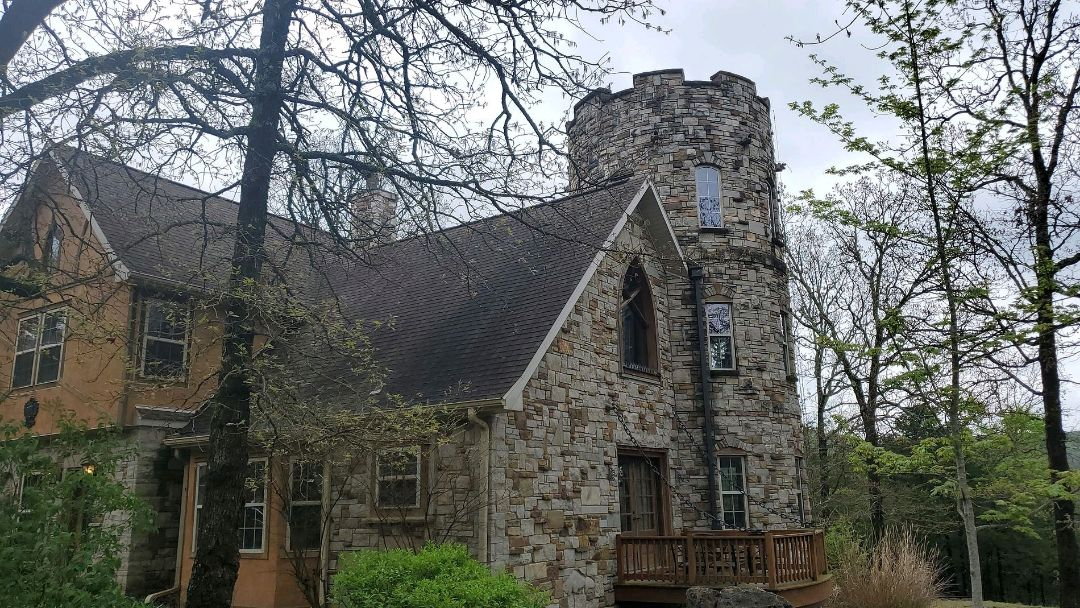 Holiday Island, AR - Major Leak repair complete on this castle turret. This is a PolyGlass Silicone roof  system. Call Quality Assurance Roofing today.