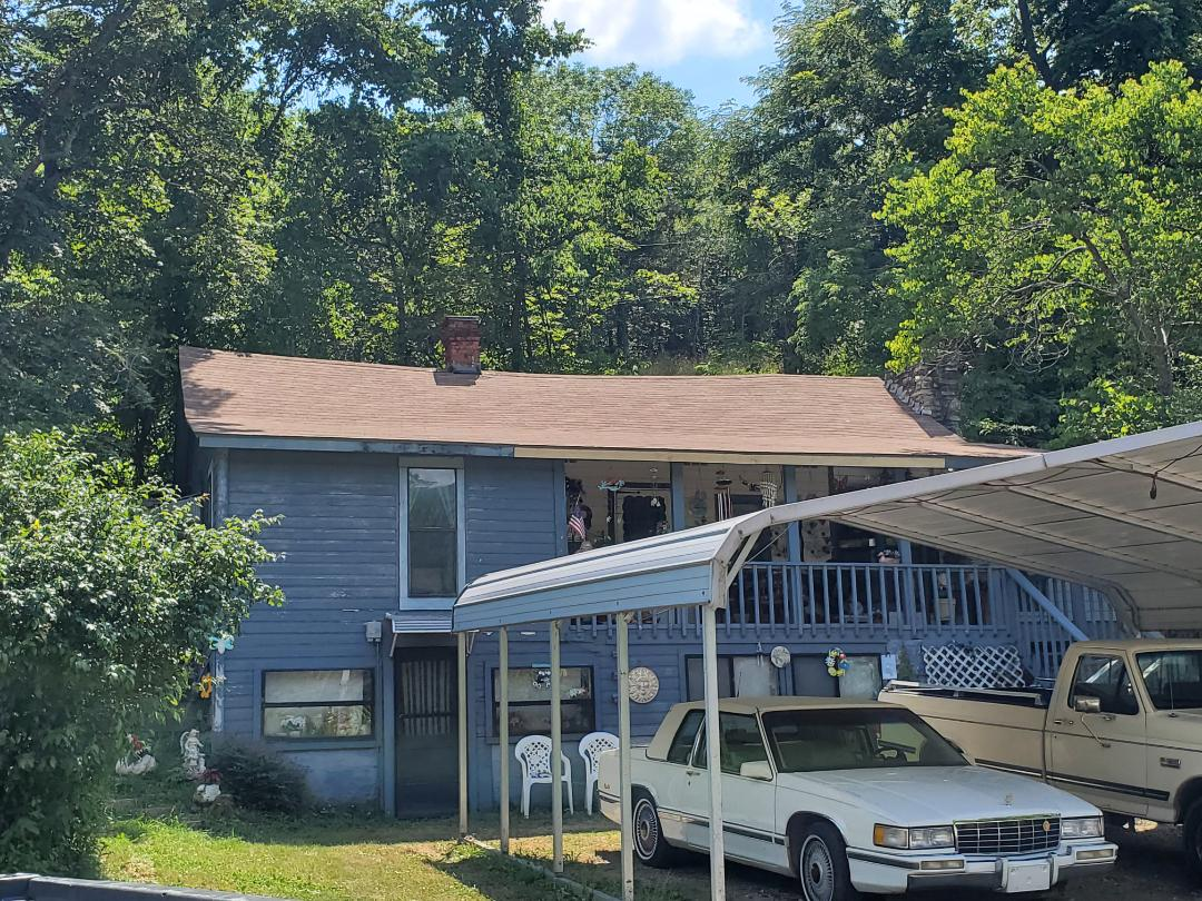 Eureka Springs, AR - Full roof replacement complete in Eureka Springs. This is a CertainTeed XT25 shingle (Resawn Shake). Call Quality Assurance Roofing today.