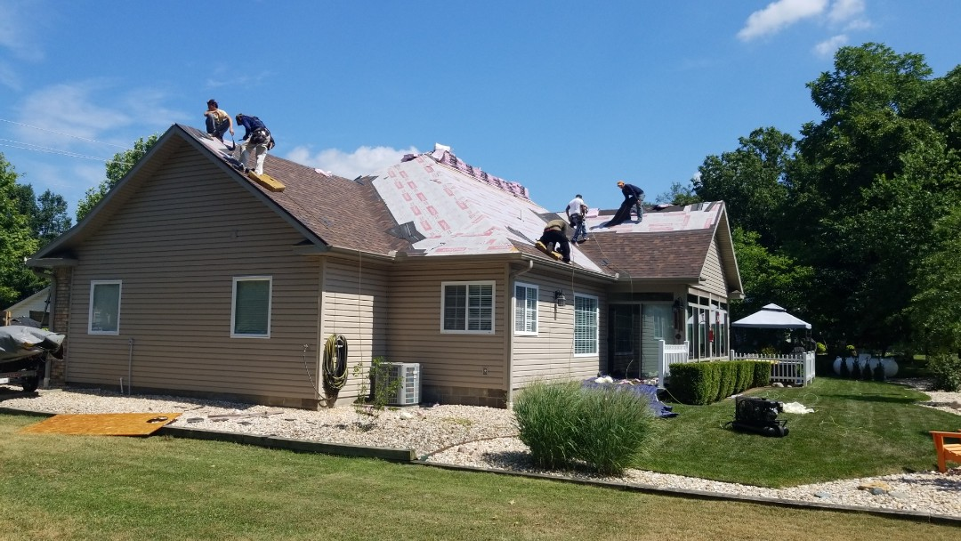 Eureka Springs, AR - Quality Assurance Roofing is starting the installation of A Owens Corning Duration Shingle in Holiday Island Ar. Roof  was Damaged from Hail on July 5 2018. Call 479-239-5469 for a Free Inspection