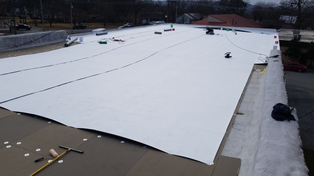 Berryville, AR - Quality Assurance Roofing is A GAF Master Contractor and Can Service All You're Commercial Roofing Needs. Were installing New ISO Board and Mil Energy Guard GAF TPO on The Historic Quality Tire In Town Sq Berryville AR