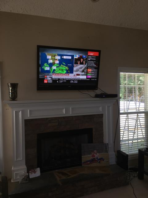 Senoia, GA - Installed recessed receptacle behind tv for wall mount above fireplace