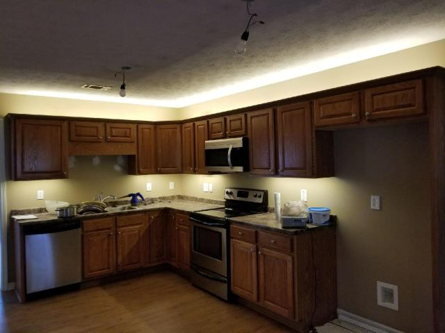 Newnan, GA - Installed LED lights over countertops and above kitchen cabinets; installed 2 dimmer switches for new lights